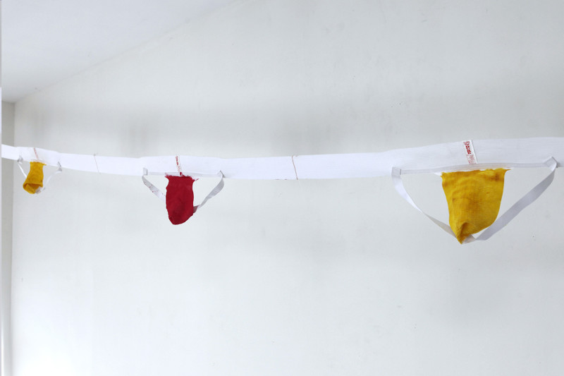 "Waterboys, Jockstraps, latex, thread, 30' x 11"" (dimensions variable), 2015"